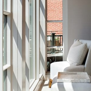 white couch overlooking windows at spa