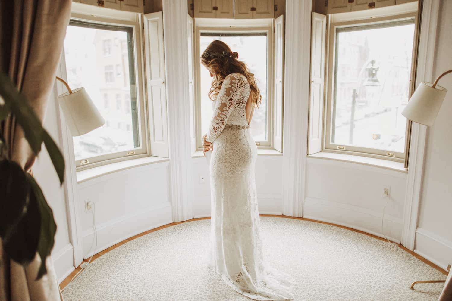 Bride stands in her wedding dress at the Ivy Baltimore.