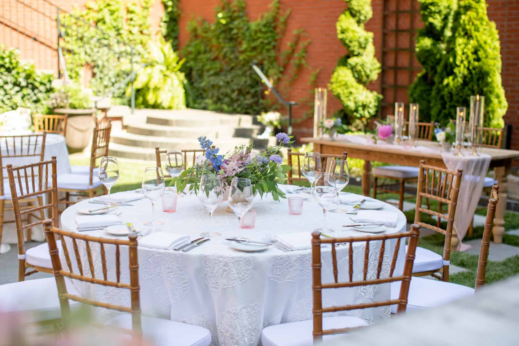 wedding guest tables with floral centerpieces and candles