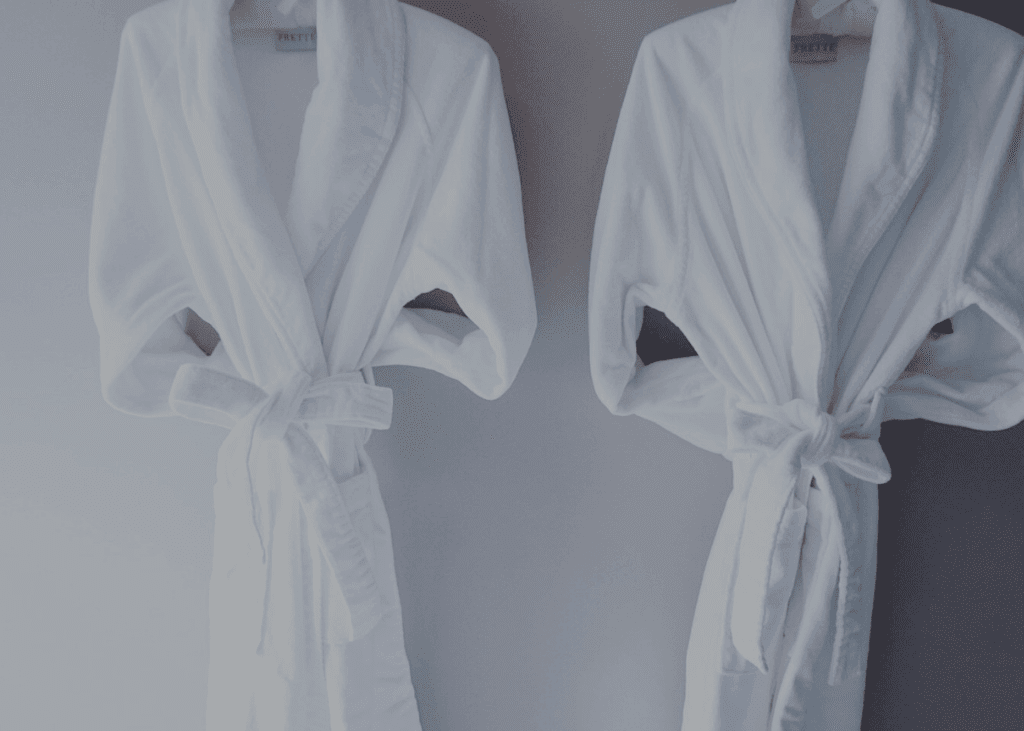 Two robes on hangers at The Spa at The Ivy.