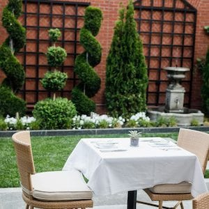Table set for two in the courtyard at Magdalena Restaurant.
