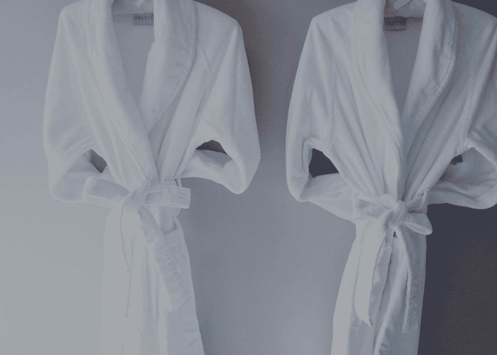 Two robes on hangers at The Spa at The Ivy Hotel.