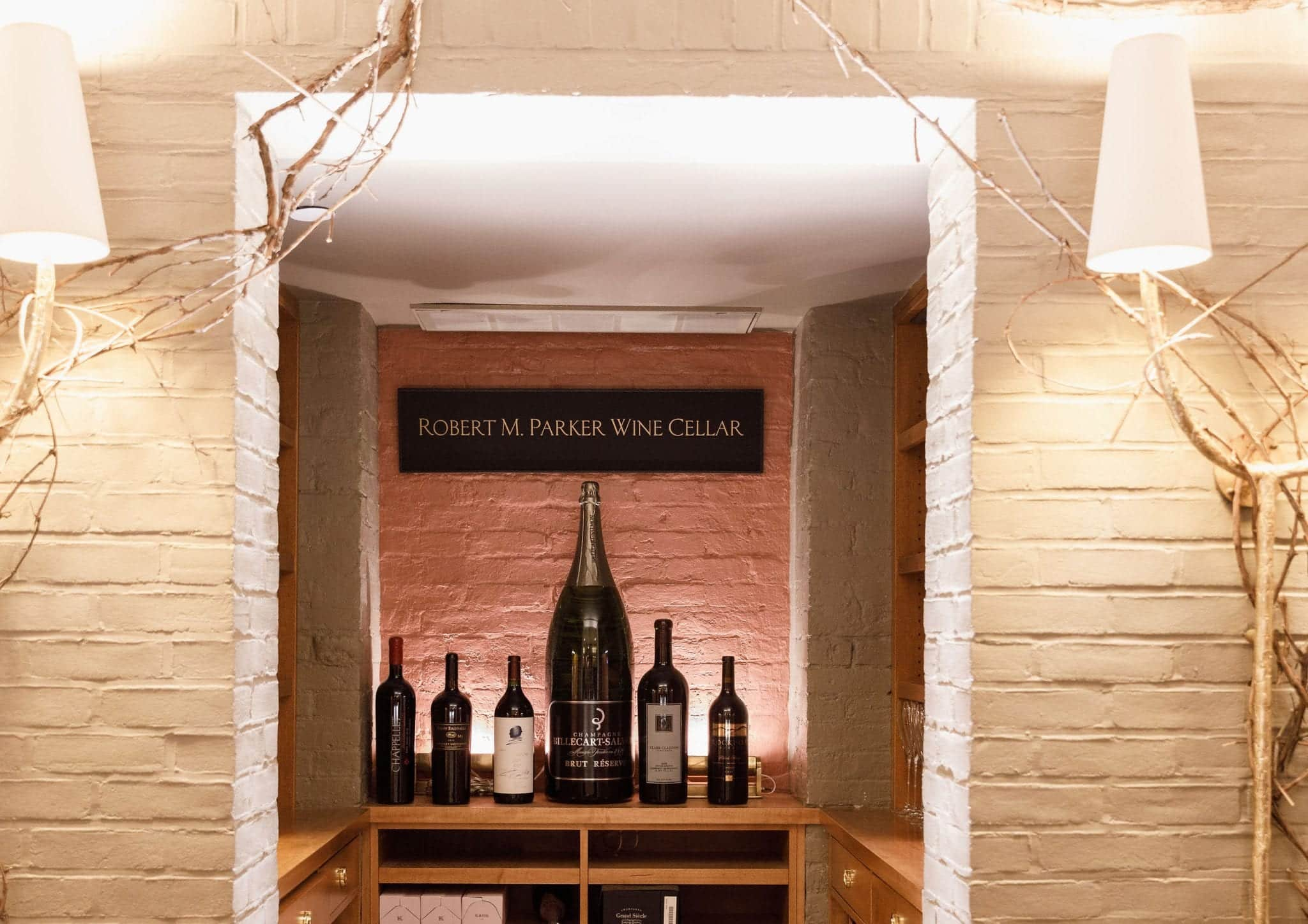 Wine on display under the Robert Parker Wine Cellar sign in Magdalena Restaurant.