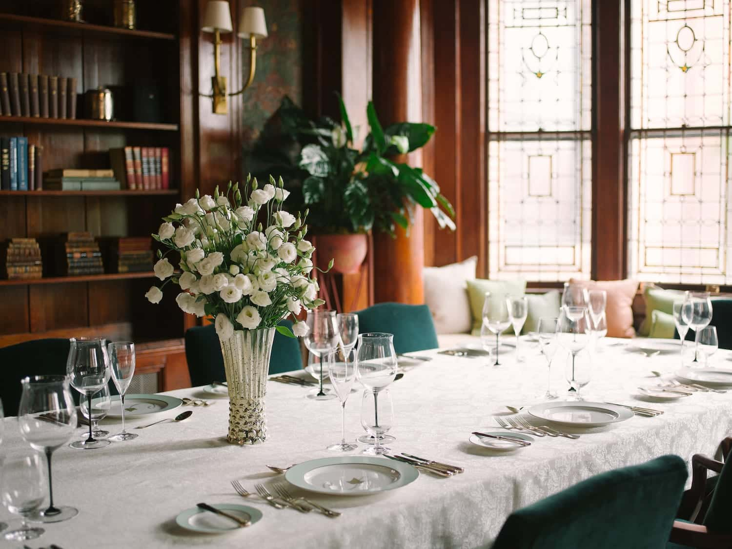Elegant dining room with white rose bouquet at The Ivy