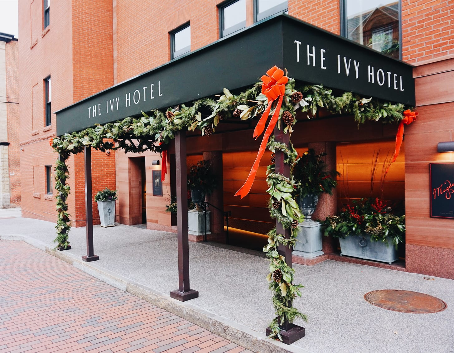 Exterior entrance of The Ivy Hotel Decorated with Holiday Garland