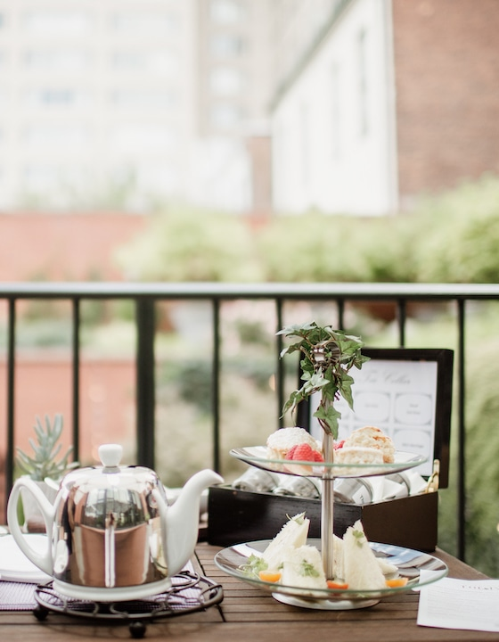 Teatime and pastries set up on balcony overlooking courtyard.
