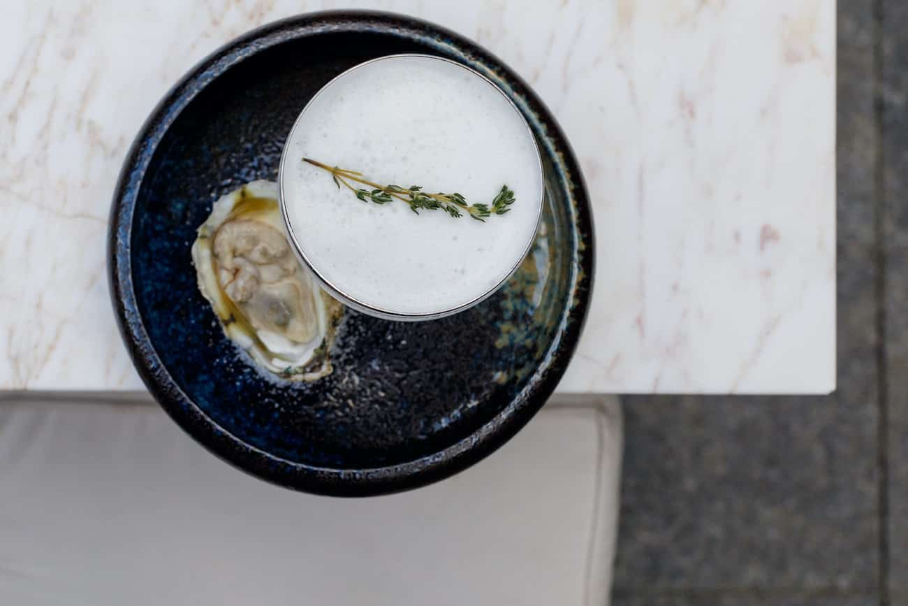 Oysters on the half shell next to freshly crafted dipping sauce.