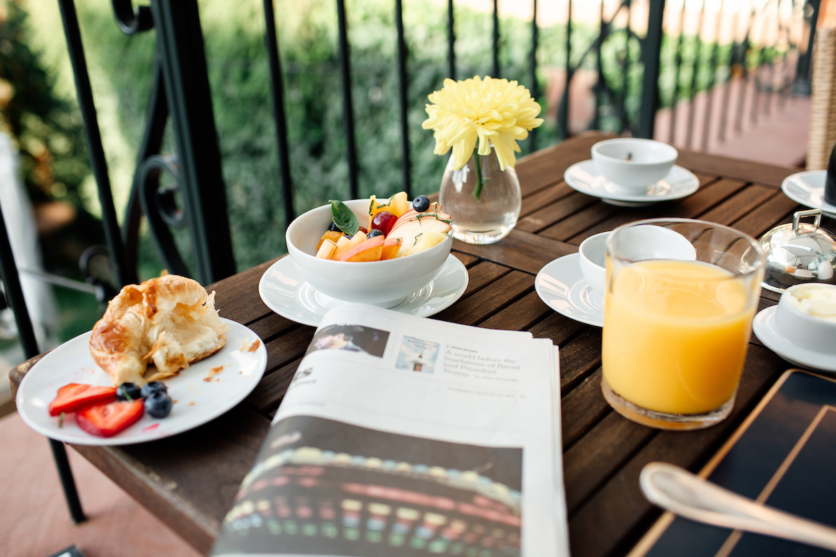 Breakfast spread outdoors on the terrace at The Ivy Hotel.