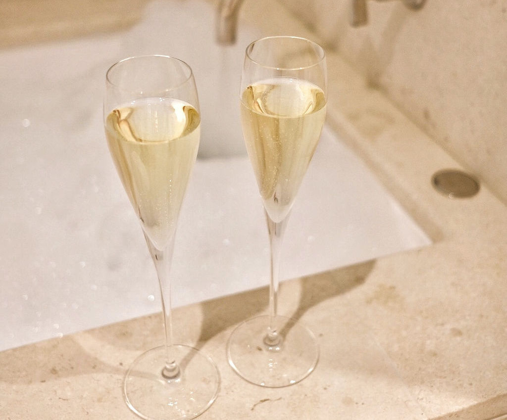 Two Glasses of Champagne with a Bubble Bath