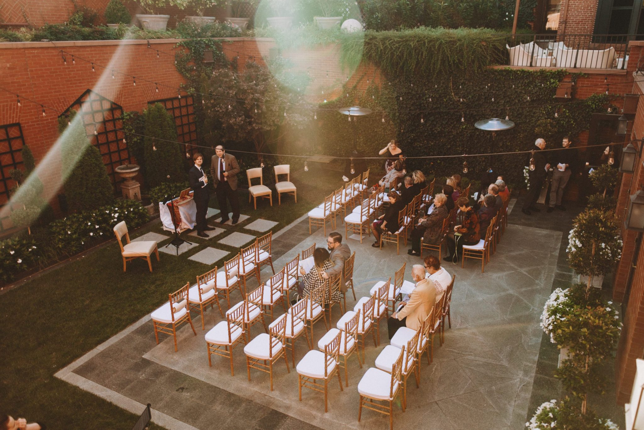 Overlooking the courtyard with guests mingling
