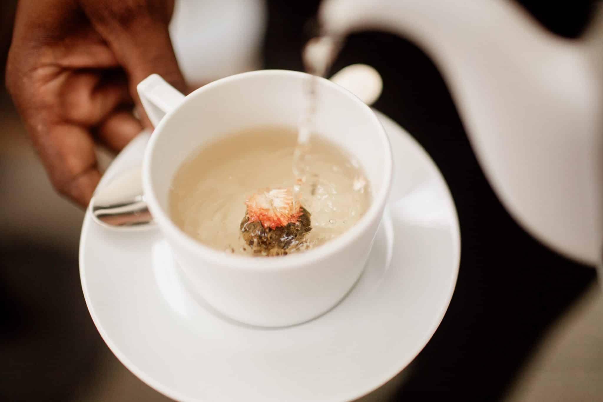 Pouring tea into a tea cup