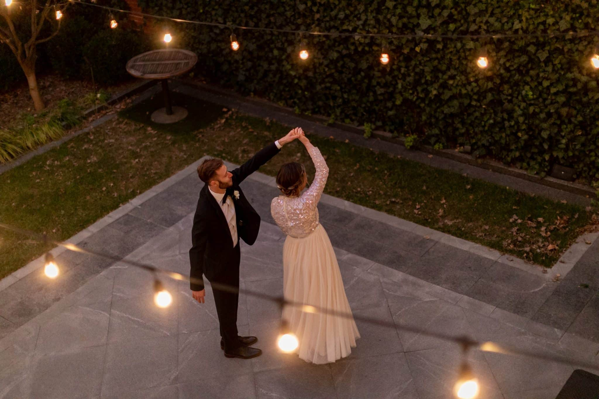 Bride and groom dancing in the courtyard