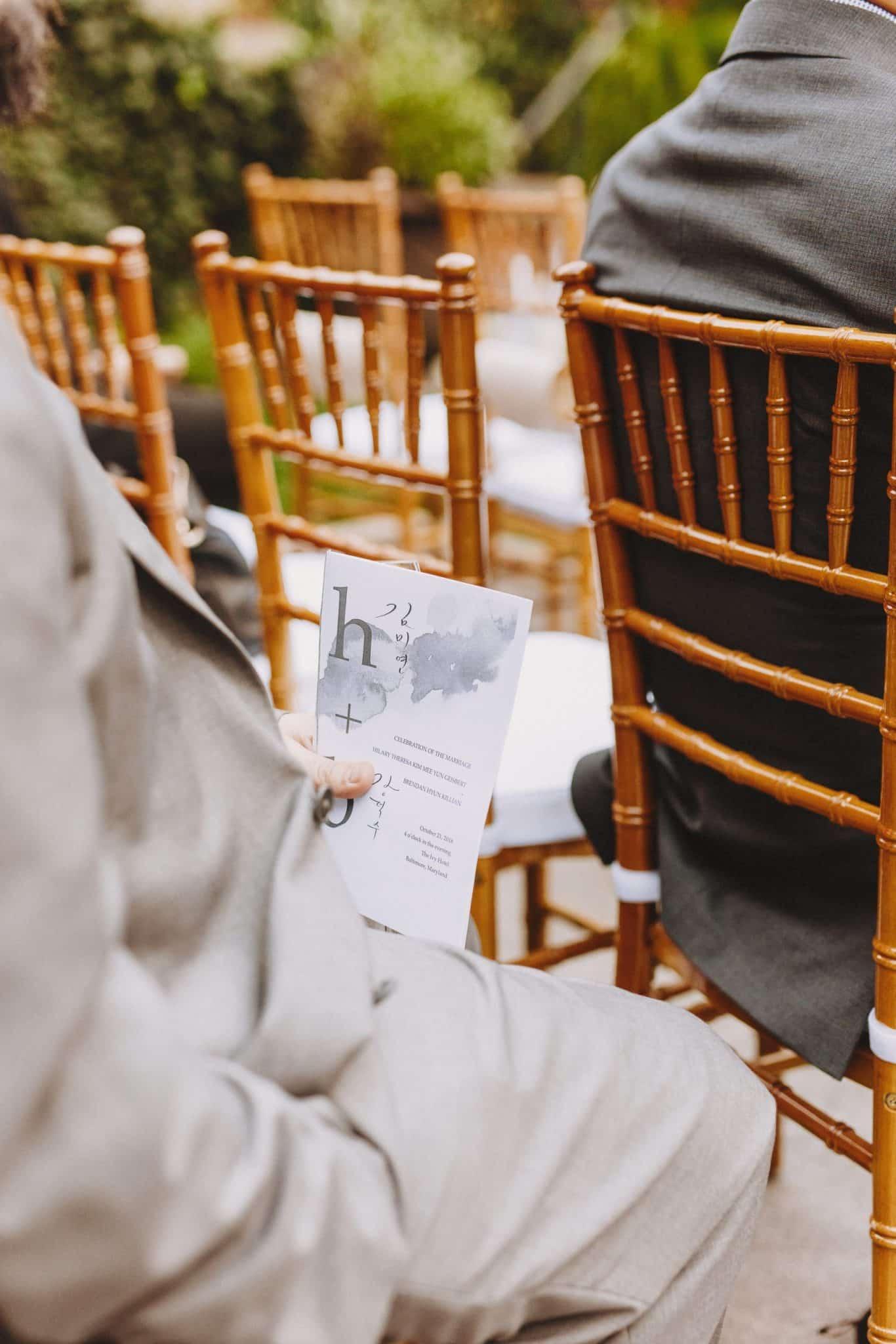 Man holding the wedding itinerary