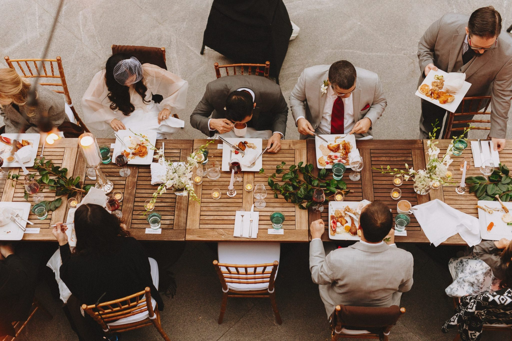 Overview shot of the wedding guests eating at the table