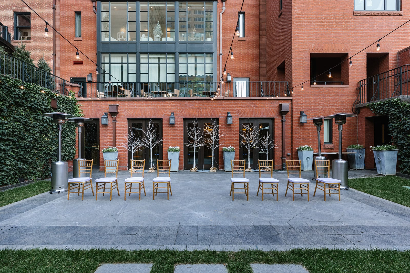 Courtyard with chairs set up for the wedding
