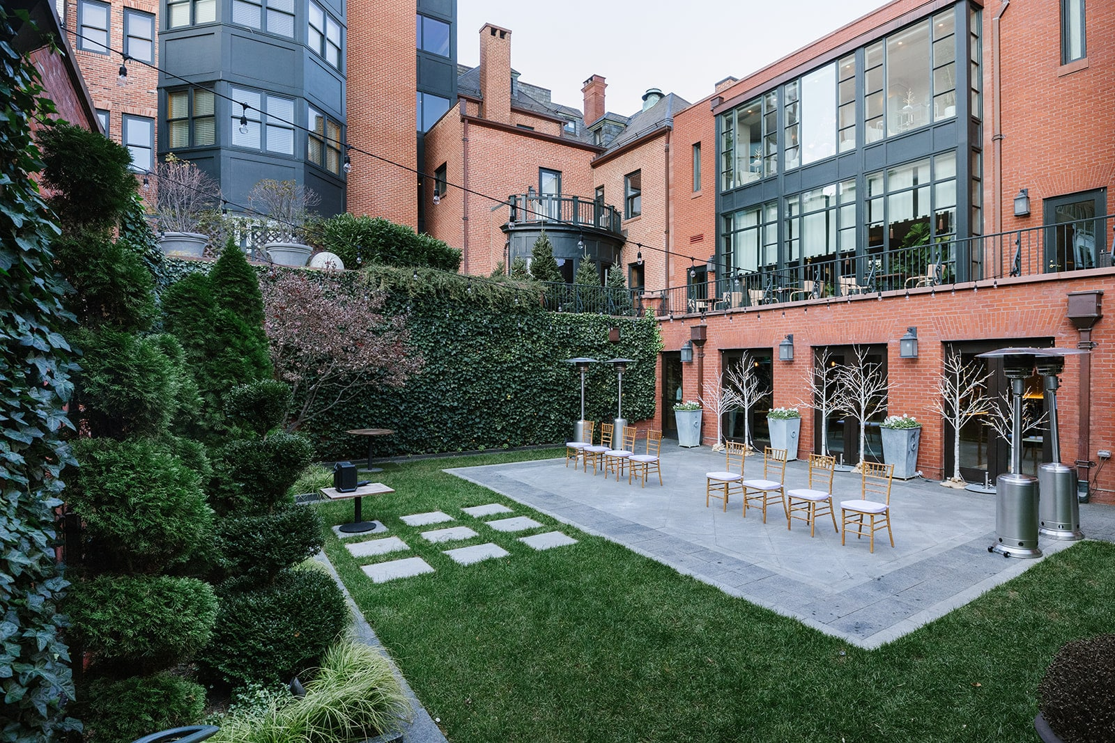 Courtyard of the Ivy with chairs for the wedding