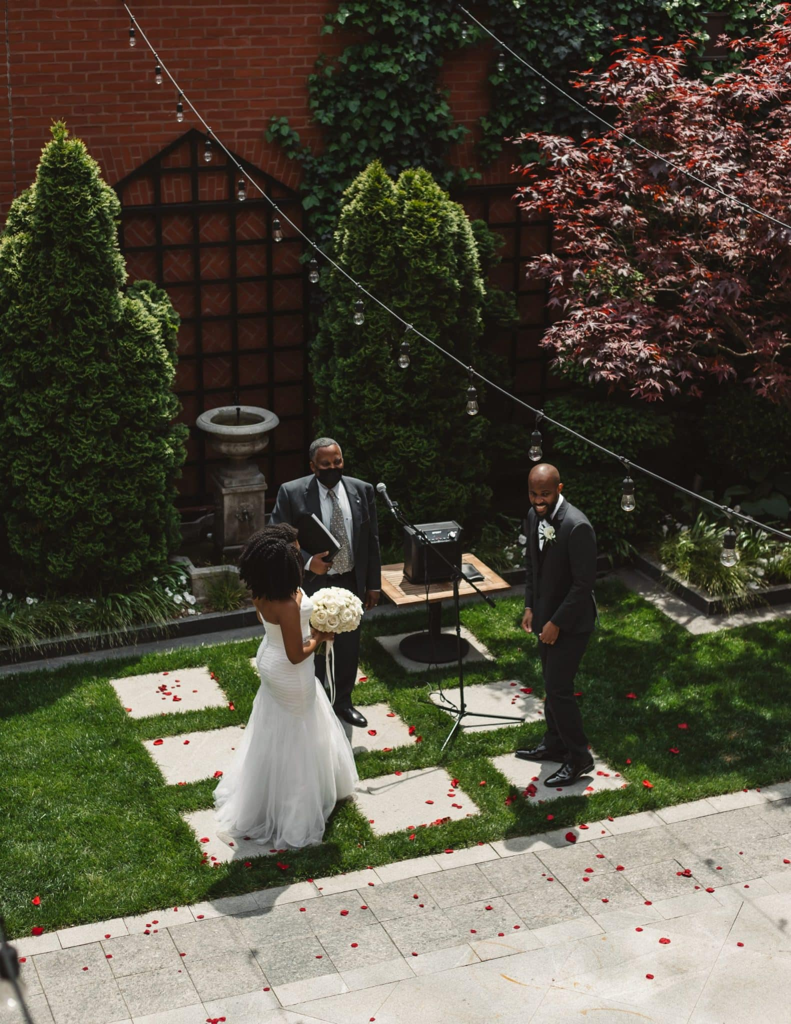 bride and groom on the courtyard at The Ivy Hotel